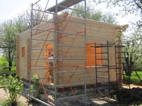 сборка коробки деревянного дома из клееного профилированного бруса.